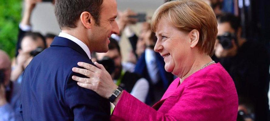 Angela Merkel and her junior sidekick, Emmanuel Macron, will support the EU's move to punish Poland.