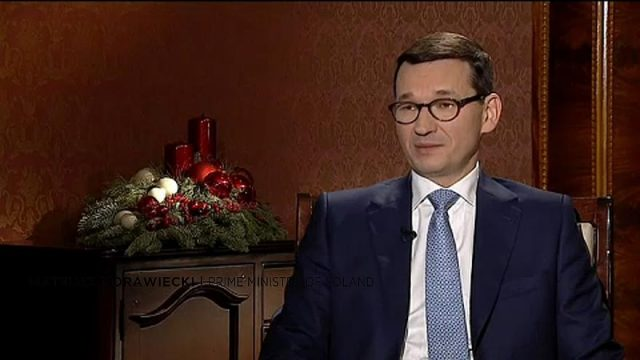 Polish Prime Minister Mateusz Morawiecki says his government won't accept migrants from North Africa or the Middle East