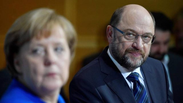 V4 Report: Merkel surrenders as Schulz and the Socialists pull a virtual coup.