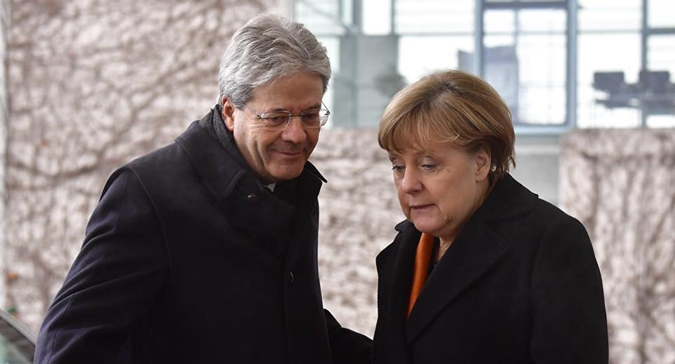 V4 Report.  Angela Merkel says Germany and Italy will insist on migrant redistribution across EU