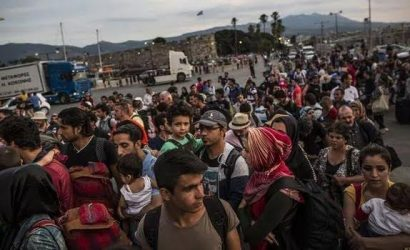 """As migrant arrivals surge in Greece, the government pleads for """"sharing of burden""""."""